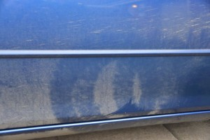 It is quite clear that the car wash was misaligned. This looks like the marks from the wheel brush - on the door!