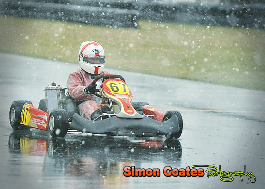 Kart number 67 racing around in the snow at Rissington Kart Club in March