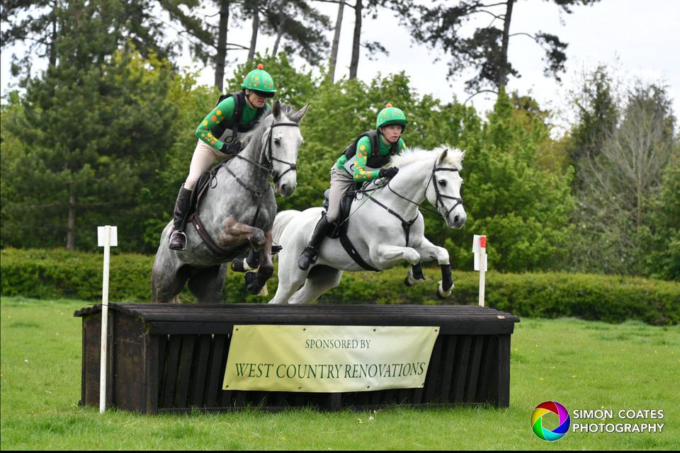 A pair of horses jumping fence 19 at Bignall