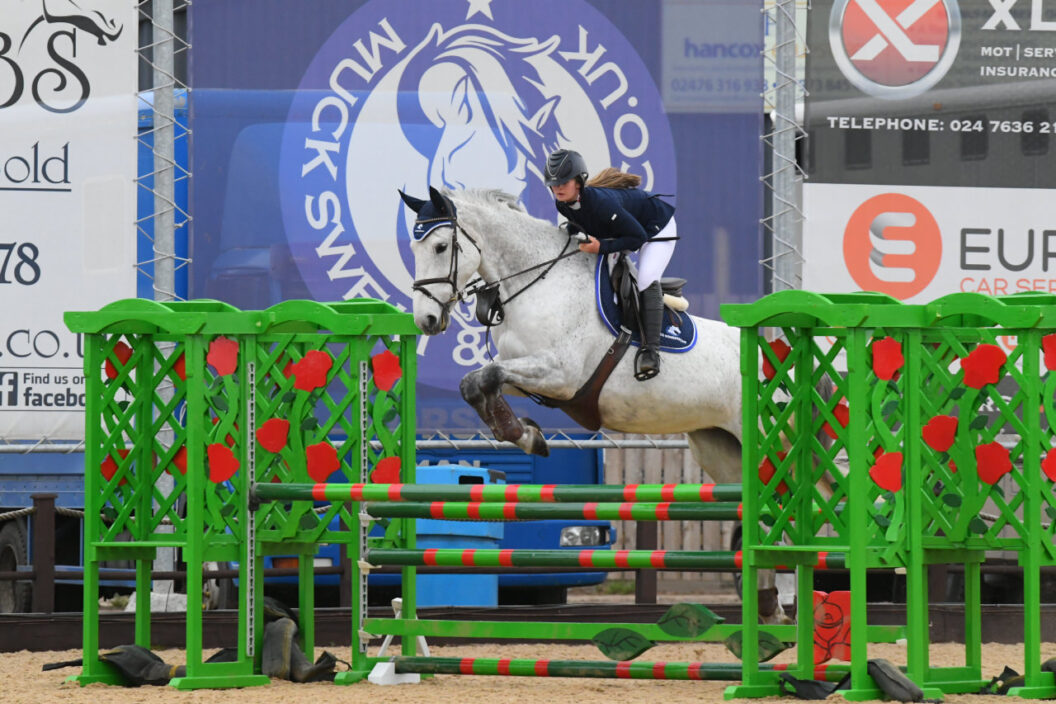 A horse and rider Show jumping at Weston Lawns Easter Eggsrtavaganza 2021